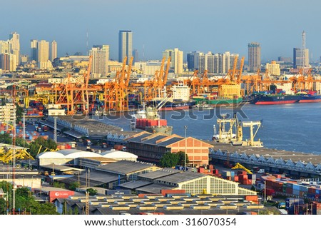 Bangkok,Thailand - June 6,2015 : Bangkok Port Authority of Thailand ,The port in Bangkok with loaded freight ship and cargo handling equipment on the side of Chao Phraya river in Bangkok,Thailand.