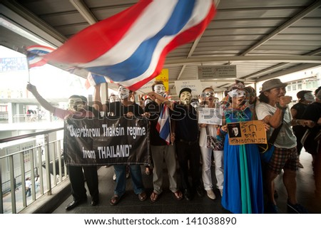 BANGKOK,THAILAND-JUNE 2 : Demonstrators from the anti-government V for Thailand group wear Guy Fawkes masks to protest against the government at the Central World on June 2,2013 in Bangkok,Thailand.