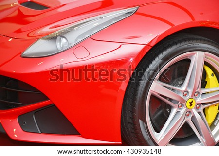 Bangkok,Thailand - JUNE 1, 2016 :  headlights and wheel of ferrari on the sport car.Italian week 2016 at Central World Shopping Mall in Bangkok. - stock photo