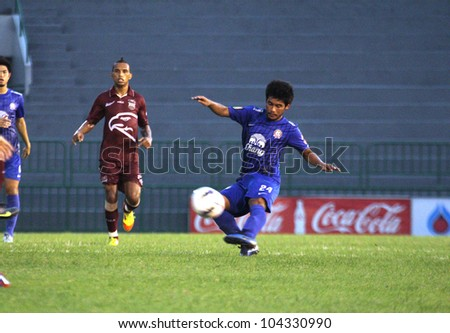 BANGKOK THAILAND - JUNE 3 : Krekrit Taveekran (R) in action during Thai Premier League (TPL) Insee Polise United (red) VS Chonburi FC (Blue) at Army Stadium on June 3,2012 in Bangkok,