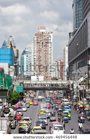Bangkok, Thailand - June 19, 2015: Picture of vehicles traffic on Phetchaburi Rd and high rise shopping building at Pratunam commercial districts