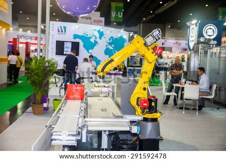 BANGKOK ,THAILAND - JUNE 20: Show robotic hand machine on work in 