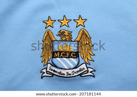 BANGKOK, THAILAND - JUNE 08, 2014: the logo of the Manchester City  football club on an official jersey of the club official  jersey on 8 June 2014 in Bangkok Thailand. - stock photo