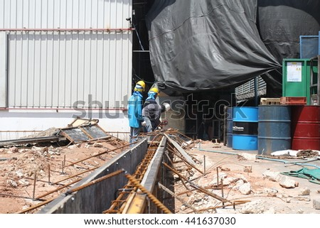 BANGKOK,THAILAND - JUNE 22 ,2016 The unidentified workers  welding a metal structure in a newly constructed  industry  on June 22 , 2016, Bangkok, Thailand