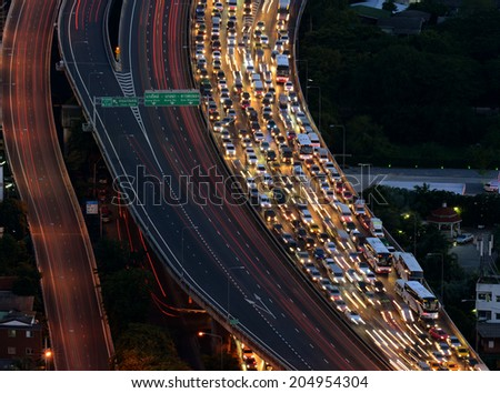 BANGKOK, THAILAND - JUNE 27 : Traffic on Express Way of Bangkok at twilight time taken June 27, 2014 in Bangkok. Bangkok is one of the most traffic problem city in the world. - stock photo