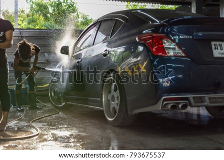 Bangkok, Thailand - June 4, 2016 : Unidentified car care staff cleaning the car (Car detailing).