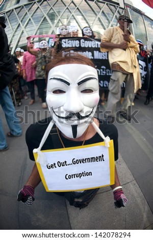 BANGKOK,THAILAND-JUNE 9 : Unidentified demonstrators from the anti - government  V for Thailand group wearing  Guy Fawkes masks attend rally outside a shopping mall on June 9,2013 in Bangkok,Thailand.