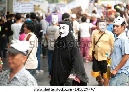 BANGKOK,THAILAND-JUNE 16 : Unidentified demonstrators from the anti- government  V for Thailand group wearing  Guy Fawkes masks attend rally outside shopping mall on June 16,2013 in Bangkok,Thailand.