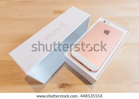 BANGKOK ,THAILAND - JUNE 25, 2016 : Unpacking of the new Apple iPhone SE combining the updated processor, 4K rear camera, touch id, retina display