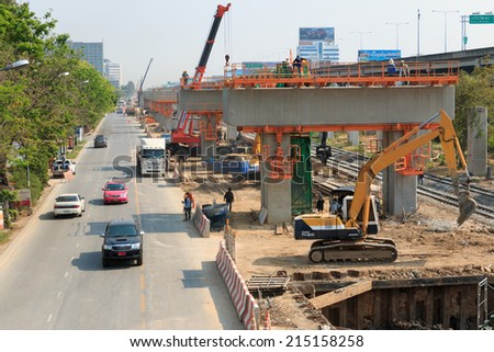 Bangkok Thailand - MAR 2 2014: Construction team were doing new sky train station project on Local road.