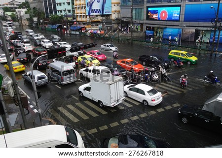 BANGKOK, THAILAND-MAR 24: Heavy downpour in inner Bangkok has caused floods on several roads and traffic jams on March 24, 2015.