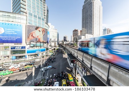 Bangkok, Thailand - March 31 2014: A BTS train rushes out of Asok station in Bangkok along Sukhumvit road. This elevated train system has helped considerably to reduce traffic congestion in the city.  - stock photo