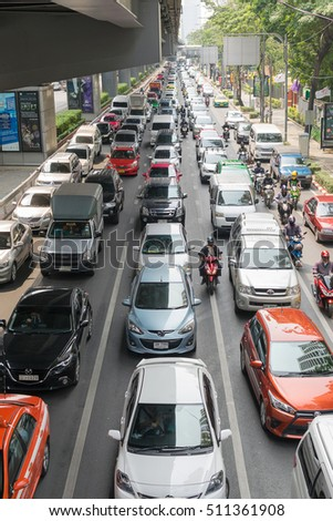 Bangkok, Thailand - March 31, 2016 : Car and Motorcycle wait to go at intersection with traffic light on a road.