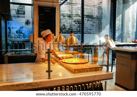 BANGKOK THAILAND - MARCH 5: Chief in white uniform making pizza in kitchen at Dean & Deluca, at Mahanakhon in Bangkok, on  March 5, 2015 in Bangkok, Thailand.