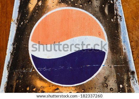 BANGKOK, THAILAND - MARCH 11, 2014: Close up old Pepsi logo printed on vintage enamel tag. Pepsi is a carbonated soft drink produced by PepsiCo, created in 1893 and introduced as Brand's Drink