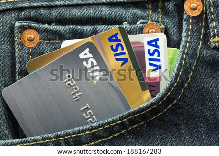 BANGKOK, THAILAND - March 24, 2014: Closeup of VISA credit card in blue denim jeans pocket. VISA is one of the three biggest brands.