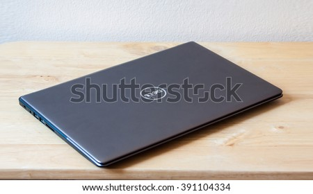 BANGKOK,THAILAND - March 14,2016: Dell Logo on notebook cover. Dell Inc. is an American multinational computer technology company that develops, sells and repairs computers.