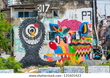 BANGKOK, THAILAND - 20 MARCH: Giant cartoon graffiti of random artist on abandon building urban of Bangkok on March 20, 2013. The building is leftover