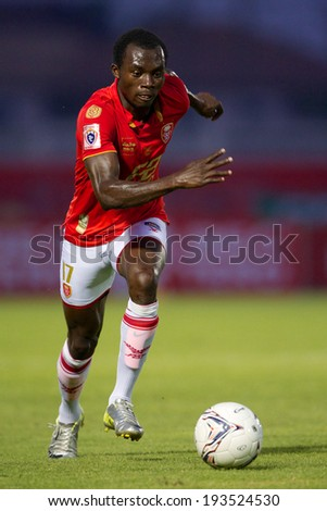 BANGKOK THAILAND-March 23:	Gilbert Koomson of BEC-Tero Sasana control the ball during Thai Premier League BEC-Tero Sasana and Chonburi F.C.at 72-years Anniversary Stadium on March 23,2014 in Thailand - stock photo