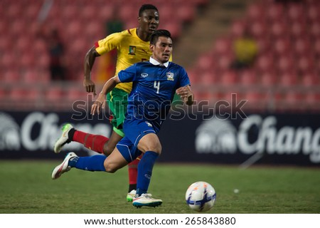 BANGKOK,THAILAND-MARCH 30:Kroekrit Thaweekarn no.4of Thailand run with the ball during the international friendly match between Thailand and Cameroon at Rajamangala Stadium on March30 2015in,Thailand. - stock photo