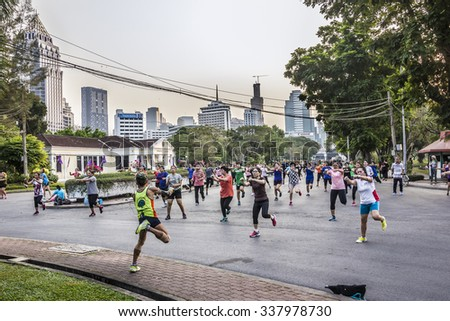 BANGKOK, THAILAND - MARCH 11, 2015: Many Thai people of every age participate in keep-fit exercises at Lumphini Park in the evening.