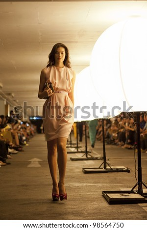 "BANGKOK, THAILAND - MARCH 25  : Model walks the runway at "" Flynow"" collection presentation during Siam Center Fashion Visionary Spring/Summer on March 25, 2012 in Bangkok Thailand."