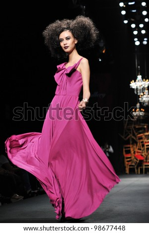"BANGKOK, THAILAND - MARCH 24 : Model walks the runway at "" Tube Gallery "" collection presentation during Siam Center Fashion Visionary Spring/Summer on March 24, 2012 in Bangkok Thailand. - stock photo"