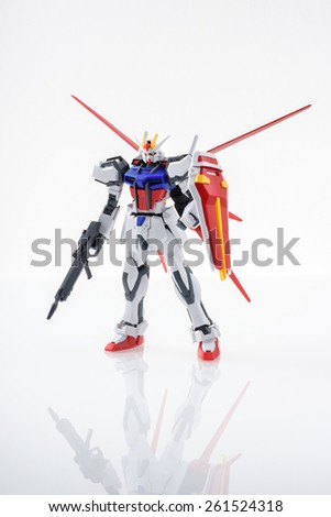 BANGKOK, THAILAND - MARCH 18, 2015: Plastic model of GAT-X105+AQM/E-X01 Aile Strike Gundam over white background. - stock photo