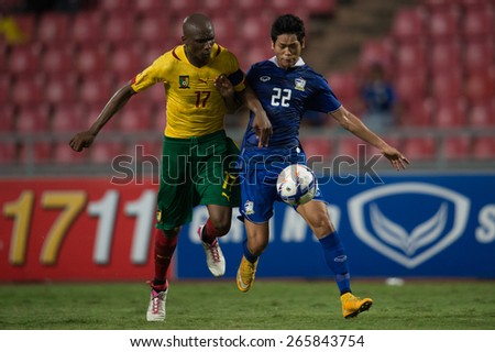 BANGKOK,THAILAND-MARCH 30:Stephane Mbia no.17(L) of Cameroon in action during the international friendly match between Thailand and Cameroon at Rajamangala Stadium on March30 2015 in,Thailand. - stock photo