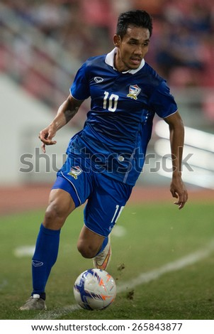 BANGKOK,THAILAND-MARCH 30:Teerasil Dangda no.10 of Thailand control the ball during the international friendly match between Thailand and Cameroon at Rajamangala Stadium on March30 2015 in,Thailand.