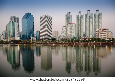 BANGKOK, THAILAND-MARCH 8 : The business skyscraper skyline is in Bangkok city downtown with reflection on wide lake in Bangkok, Thailand March 8, 2015