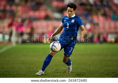 BANGKOK,THAILAND-MARCH 30:Theeraton Bunmathan of Thailand in action during the international friendly match between Thailand and Cameroon at Rajamangala Stadium on March30 2015 in,Thailand. - stock photo