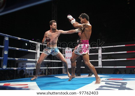 BANGKOK, THAILAND- MARCH 16 : Unidentified athletes compete in the 2012 World Amateur Muaythai Championships on March 16, 2012 at National Stadium in Bangkok, Thailand