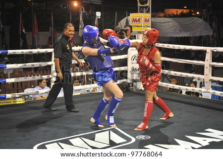BANGKOK, THAILAND- MARCH 14 : Unidentified athletes compete in World Amateur Muaythai Champioships 2012. on March 14, 2012 at  National Stadium, Bangkok, Thailand