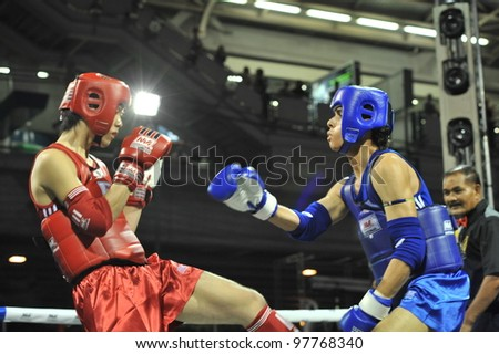 BANGKOK, THAILAND- MARCH 14 : Unidentified athletes compete in World Amateur Muaythai Champioships 2012. on March 14, 2012 at  National Stadium, Bangkok, Thailand - stock photo