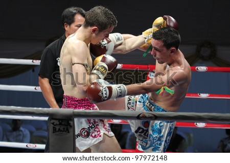 BANGKOK, THAILAND- MARCH 16 : Unidentified athletes compete in World Amateur Muaythai Champioships 2012. on March 16, 2012 at National Stadium, Bangkok, Thailand
