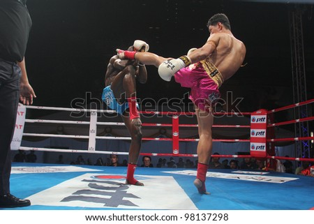 BANGKOK, THAILAND- MARCH 16 : Unidentified athletes compete in World Amateur Muaythai Champioships 2012. on March 16, 2012 at National Stadium, Bangkok, Thailand - stock photo