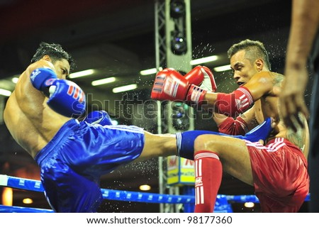 BANGKOK, THAILAND- MARCH 21 : Unidentified athletes compete in World Amateur Muaythai Champioships 2012. on March 21, 2012 at National Stadium, Bangkok, Thailand - stock photo