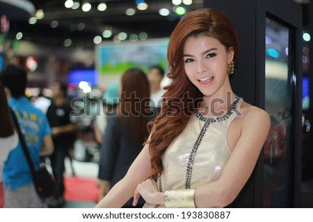 BANGKOK, THAILAND - MARCH 30, 2014: Unidentified model with Mazda pose in the 35th Bangkok International Motor Show on March 30, 2014 in Bangkok, Thailand.