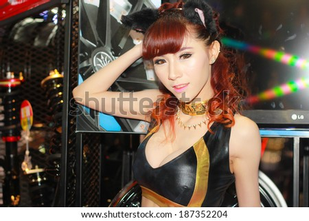 BANGKOK, THAILAND - MARCH 30, 2014: Unidentified model with PP Superwheels in the 35th Bangkok International Motor Show on March 30, 2014 in Bangkok, Thailand.