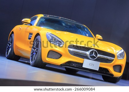 BANGKOK, THAILAND - MARCH 24 : Yellow Mercedes Benz GTS displayed at the 36th Bangkok International Motor show  in March 24, 2015. Bangkok, Thailand - stock photo