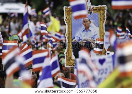 BANGKOK, THAILAND - MAY 30 : A protesters holds a portrait of the Thai King while participating in an anti-government rally on MAY 30, 2012 at BANGKOK, THAILAND. - stock photo