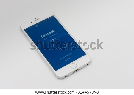 BANGKOK, THAILAND - MAY 7, 2015. Apple Iphone 6 in white color with facebook page laying on white background. - stock photo