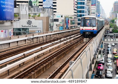 BANGKOK, THAILAND - 07 MAY 2014: BTS metro Skytrain runs through the city center above cars at roads. BTS or the Skytrain is an elevated rapid transport system in Bangkok.