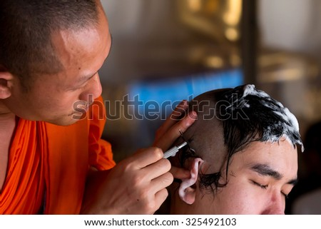 BANGKOK, Thailand - MAY 11, 2015: Ceremony remove hair before to be monk.The ritual culture of buddhism in Thailand,man must to be monk once in life.