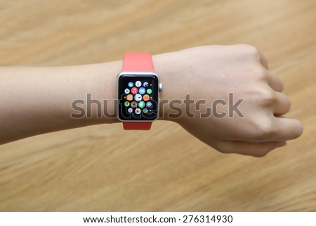 BANGKOK, THAILAND -MAY 7, 2015: close up image of the new apple watch sport on woman wrist on MAY 7, 2015 in Bangkok Thailand - stock photo
