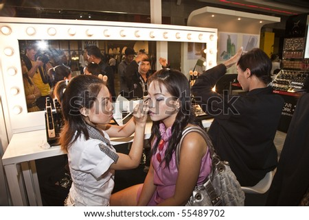 BANGKOK, THAILAND - MAY 11: cosmetic company AMWAY sponsors a makeup course with its products in the central world center and assists woman in using products , May 11, 2009 in Bangkok, Thailand