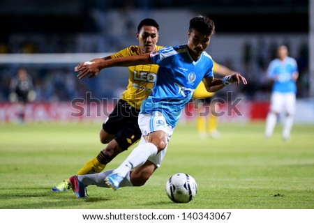 BANGKOK, THAILAND- MAY 29:DF 	Lee Jun-Ki of TOT SC.compete for the ball during  Thai Premier League  between TOT SC and Bangkok Glass F.C. on MAY 29, 2013 at TOT Stadium in Bangkok, Thailand