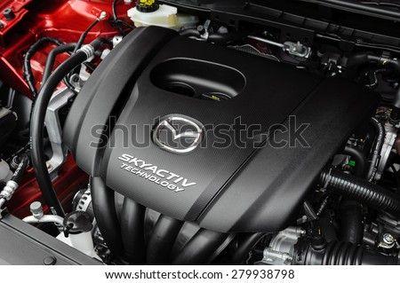 BANGKOK, THAILAND - MAY 20, 2015: Engine of All New Mazda 2 with SKYACTIV Technology. SKYACTIV is a brand name of technologies developed by Mazda which increase fuel efficiency and engine output. - stock photo