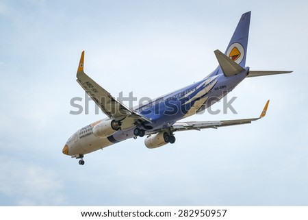 BANGKOK, THAILAND - MAY 20, 2015: HS-DBN Nok Air Boeing 737-800 landing to Don Mueang International Airport Thailand. Nok Air company is the largest low cost airlines in Thailand.